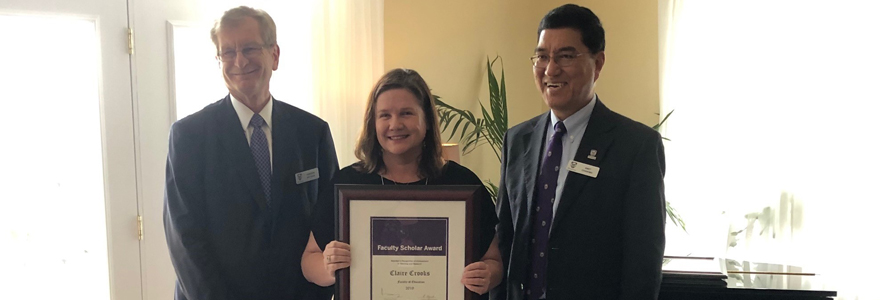 Claire accepts her faculty scholar award from Andrew Hrymak (Western University Provost & Vice-President of Academics) and Amit Chakma (Western University President & Vice-Chancellor) on April 24, 2019.