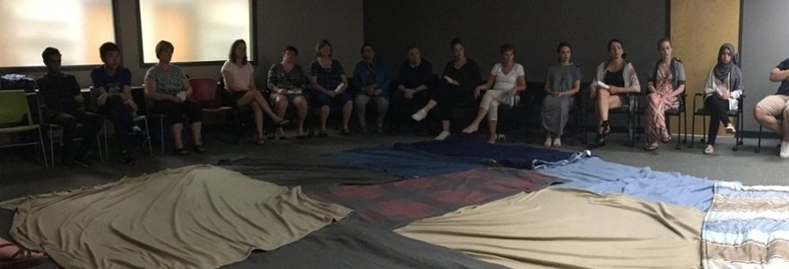 Participants take part in the Kairos Blanket Exercise.
